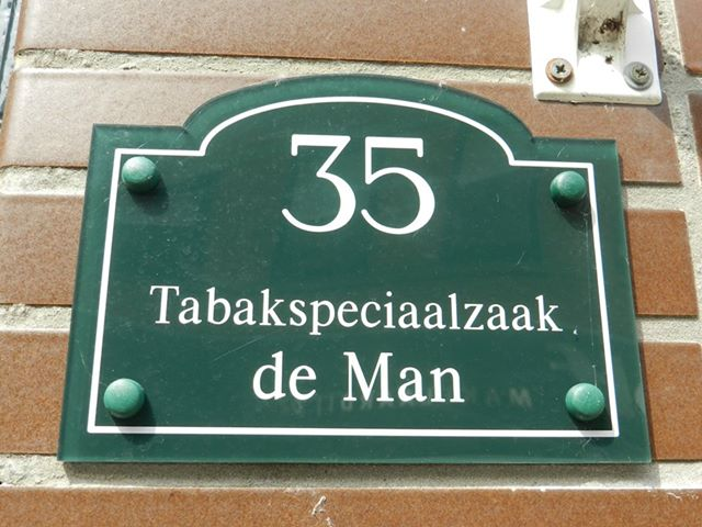 de man naambord